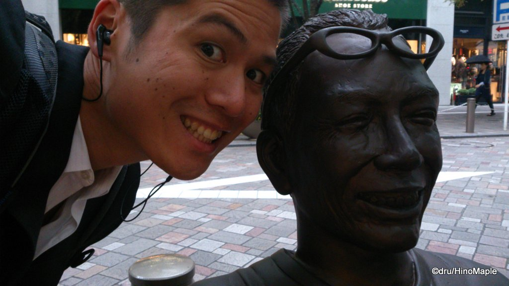 Me with a statue of a famous comedian, before work. Circa 2012.